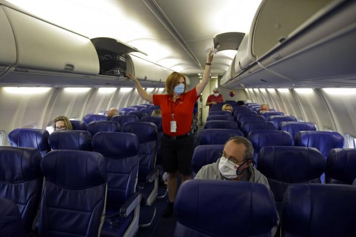 A Southwest Airlines flight attendant prepares a plane bound for Orlando, Fla.