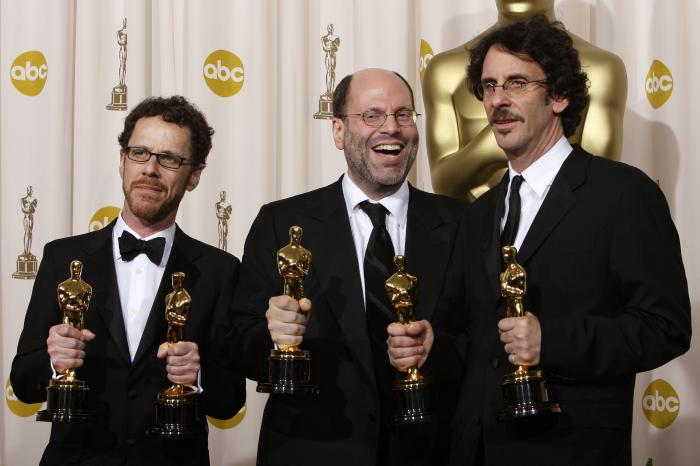 "Writer-director Ethan Coen, from left, producer Scott Rudin and writer-director Joel Coen pose with their Oscars after the film ""No Country for Old Men"" won best motion picture of the year at the 80th Academy Awards"