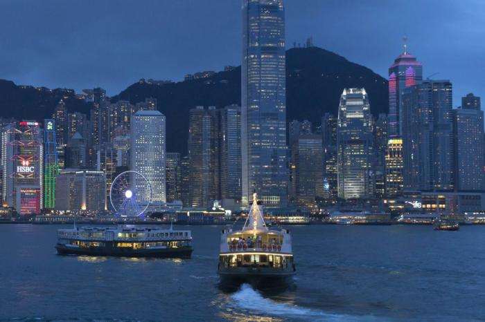This June 20, 2017, photo, shows a general view of Victoria Peak and Central district over Victoria Harbor, in Hong Kong.